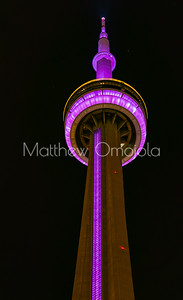 Top of CN Tower Toronto Canada at night with pink lighting