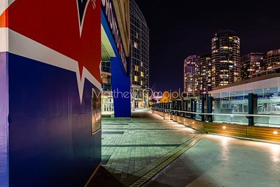 Walkway around CN tower at night. Toronto high rises at night