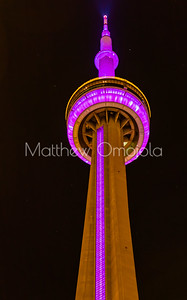 Close up top of CN Tower Toronto Canada at night with pink lighting