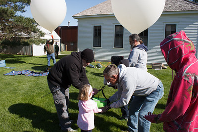 Jack (WY0F) helps my Granddaughter hold the SSTV payload.
