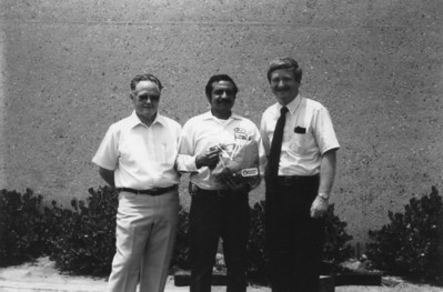 Chet Ott and Redwine with an employee