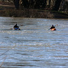 Two kayakers brave the swollen Potomac near Harpers Ferry