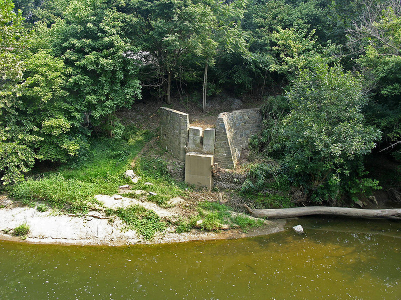 8/13/2005   Eastern side abutment and wing walls of a concrete beam bridge that was installed parallel to the Catoctin Creek Aqueduct to link the severed towpath after the aqueduct collapsed in 1973. This temporary footbridge lasted only until another flood in 1976.