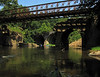 View of Catoctin Aqueduct, The Bailey Bridge, and the B&O Railroad Viaduct from a kayak in the middle of Catoctin Creek.