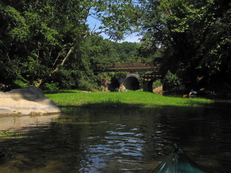 C&O Canal Association paddlers approaching the Catoctin Creek Aqueduct.