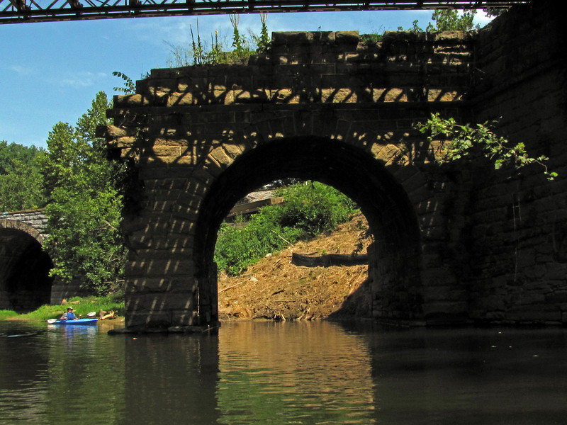 The still standing Catoctin Aqueduct eastern arch as viewed by kayak in Catoctin Creek.