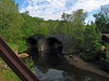 Governor Martin O'Malley's photographer photographs the Catoctin Creek Aqueduct from over on the B&O Viaduct.