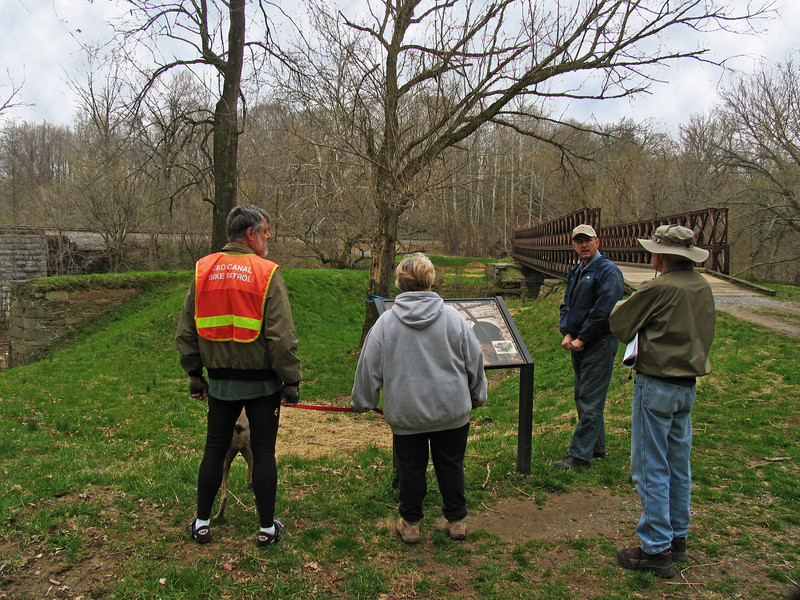4/06/2008   Dr. George E. Lewis, President of the Catoctin Creek Aqueduct Restoration Fund met with visitors to the C&O Canal Catoctin Creek Aqueduct on April 6th, 2008 during Frederick County's Bell and History Days, a countywide event presented by the Frederick Historic Sites Consortium. Present are C&O Canal Volunteer Bike Patrollers Don Goodwin and Nate Bickford.