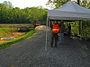 Bike patroller Nate Bickford assists with setup for the April 24, 2010 Groundbreaking Ceremony for Restoration of the Catoctin Creek Aqueduct.