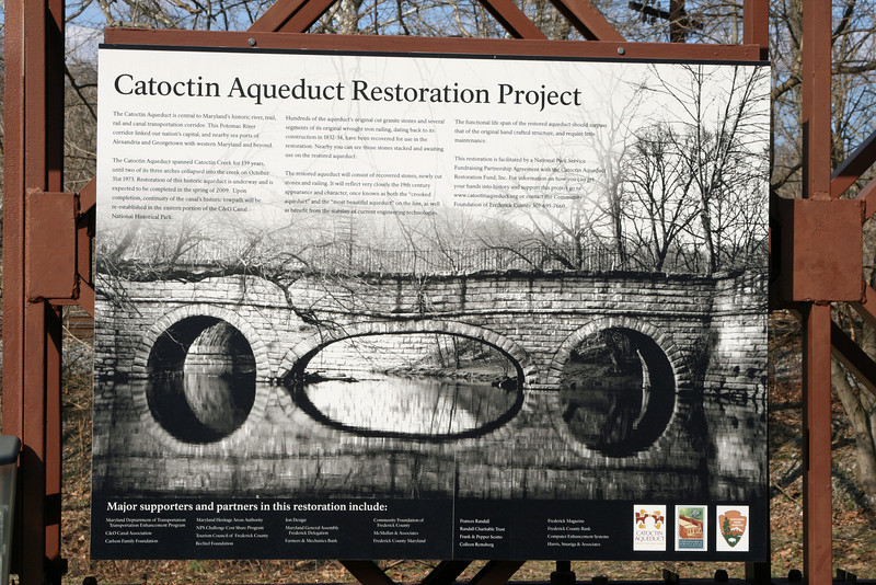 2/15/2009   This informational sign about Catoctin Aqueduct Restoration Project is attached to the side of the Bailey Bridge over Catoctin Creek.