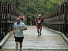9/27/2008   C&O Canal Volunteer Phil Ruth, runner 113, crossing the Bailey Bridge over Catoctin Creek during the September 27, 2008 2nd Annual Catoctin Aqueduct Benefit 10 & 5K Run-Walk.