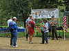 9/27/2008   The 2nd Annual Catoctin Aqueduct Benefit 10 & 5K Run-Walk race director, Pepper Scotto, presents an award to runner and park volunteer Phil Ruth during the awards ceremony after the race. Looking on in the backround are Dr. George E. Lewis, President of the Catoctin Creek Aqueduct Restoration Fund and C&O Canal National Historical Park Ranger and volunteer coordinator John Noel.