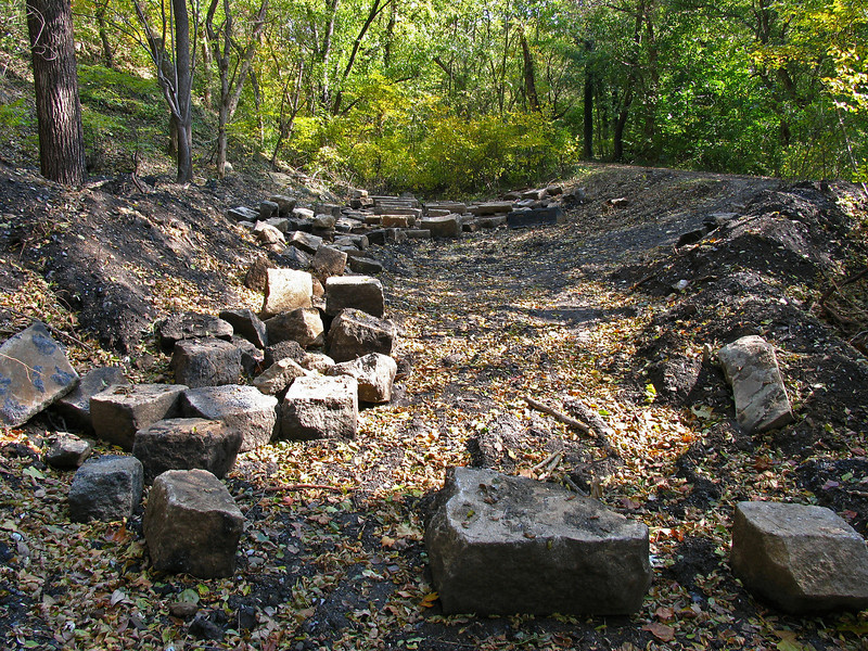 10/22/2006   Hundreds of recovered original cut granite stones and several segments of wrought iron railing stored in the old C&O Canal prism. Many will be used in the Catoctin Creek Aqueduct restoration project.