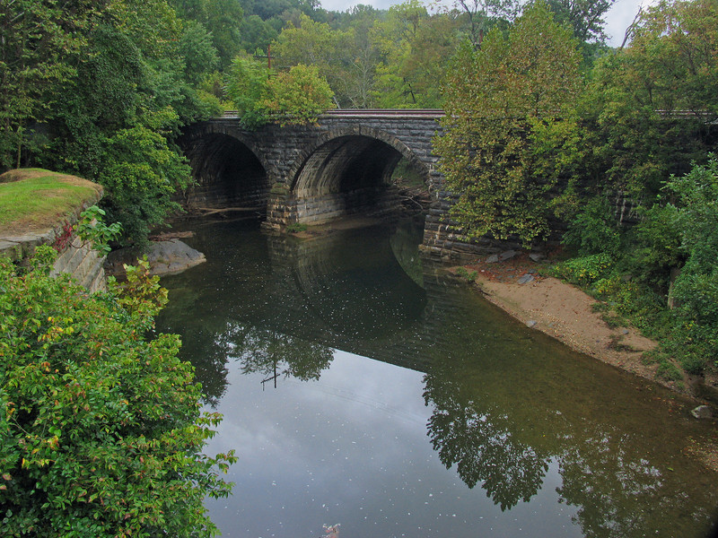 9/27/2008   View of the B&O stone railroad bridge from the C&O Canal Bailey Bridge. The decision to construct the railroad bridge of stone was Caspar Wever's who was superintendent of constuction for the railroad. Wever's decision has withstood the test of time and ravages of floods for over 160 years.