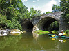 C&O Canal Association member Doug Zveare in his Wilderness Pungo 120 Kayak in Catoctin Creek approaching the  B&O Railroad Catoctin Viaduct.