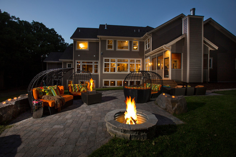 Edina, MN - Donnay Home in Edina from Luxury Home tour 2013 here today, Friday June 28, 2013.  Exterior views at dusk, fire pit front of home. Photo by © Todd Buchanan 2013 Technical Questions: todd@toddbuchanan.com; ASCO Contact: photos@asco.org
