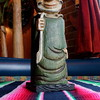 Just because it's a clown doesn't make it not creepy.<br /> Prohibition bottle carrier.