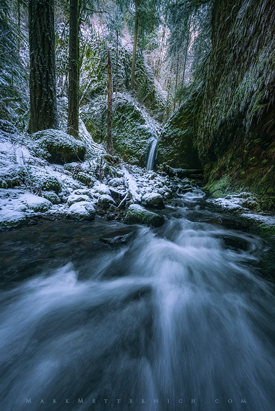 Mossy Grotto Falls during a snow and ice storm.