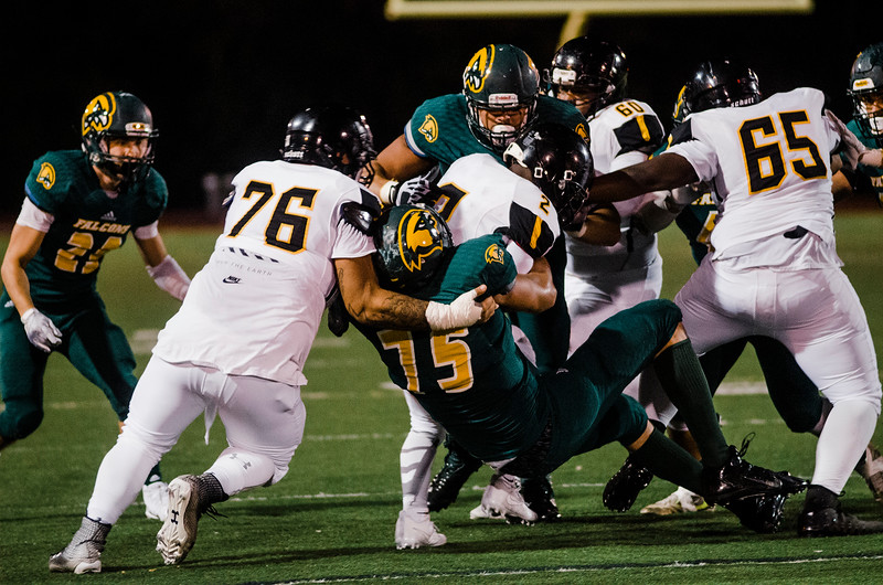 The Fitchburg State defense brings down a ball carrier during the game against Framingham State on Friday, October 6, 2017. SENTINEL & ENTERPRISE / Ashley Green