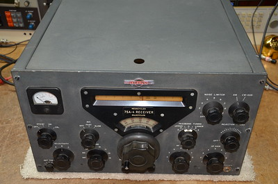 """Here is the receiver as I received it, with a lot of grunge on the front panel and the typical Collins """"yellow"""" dial scale."""