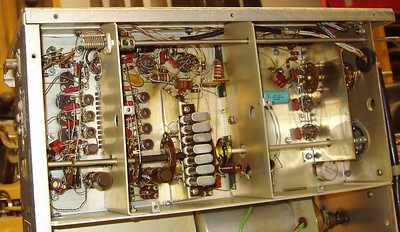 """The receiver's RF """"Front end"""", from left to right.    The RF amp, first mixer/HF Oscillator and """"band"""" crystals, the second mixer, and finally the First IF and Mechanical filters,behind the final partition at the far left."""