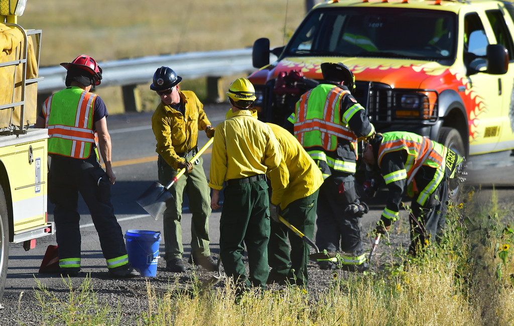 . Firefighters check on fires popping up around the scene of a fatal crash on Colorado 93 south of Boulder on Monday afternoon.  For more photos go to dailycamera.com  Paul Aiken Staff Photographer Sept 18 2017