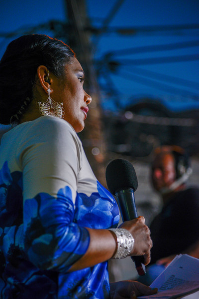Television on-air personality live from the outdoor stage at the Semana Santa Celebration in Mompox.