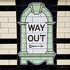 LONDON, UK - April 13, 2015 : Way Out sign, painted on the wall tiles in London