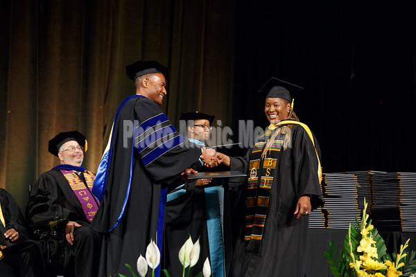 BSU Graduates Shake and Grip Photos