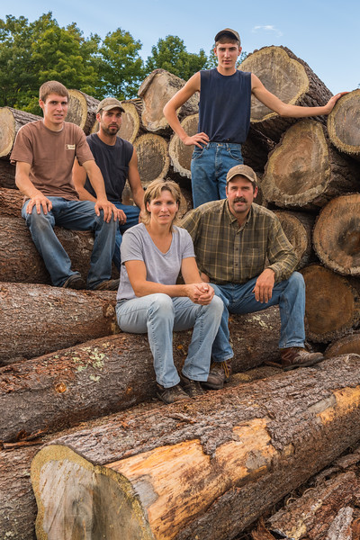 Mike and Jamie Henschel and their sons Mark, Brian (brown shirt) and Kevin (standing). The Henschel Farm and Sawmill in Carlsville, Door County, WI. Photo by Len Villano.