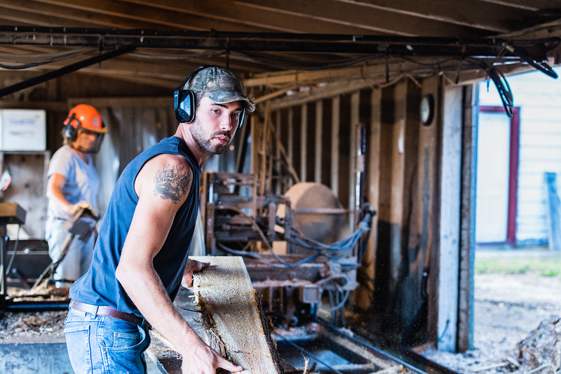Jamie and Son Mark Henschel working in the sawmill. The Henschel Farm and Sawmill in Carlsville, Door County, WI. Photo by Len Villano.