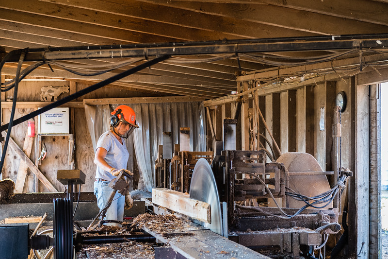 Jamie Henschel working in the sawmill. The Henschel Farm and Sawmill in Carlsville, Door County, WI. Photo by Len Villano.