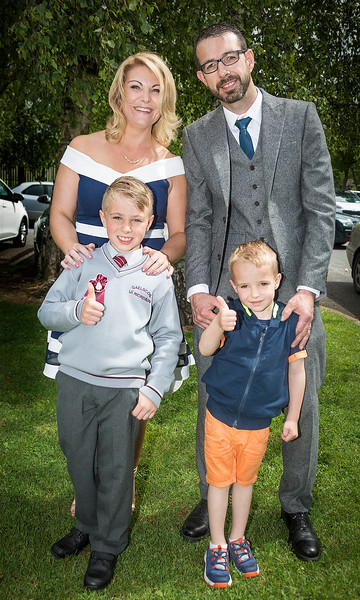 EEEjob 27/05/2017 First Communion at Christ of our Light Church, Ballincollig . Pictured, Donnacha Dwyer from Ballincollig after receiving his first communion at Christ of Our Light Church, Ballincollig on Saturday also pictured Ciara Dwyer, Colum Dwyer and younger brother Gearoid.  Picture: Andy Jay