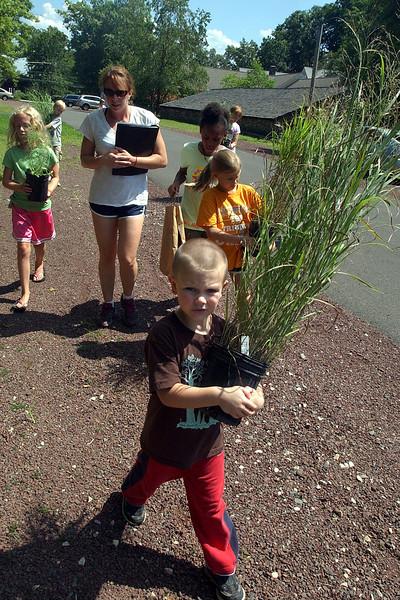 Kids planting at Gwynedd Meetinghouse