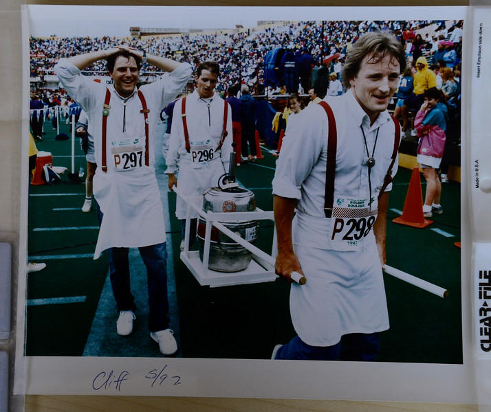 Three men finish the race with a keg of beer in the 1992 Bolder Boulder. <br /> Photo by Cliff Grassmick