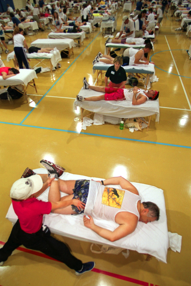 Massages are given out in the Balch Field House after the 2001 Bolder Boulder.