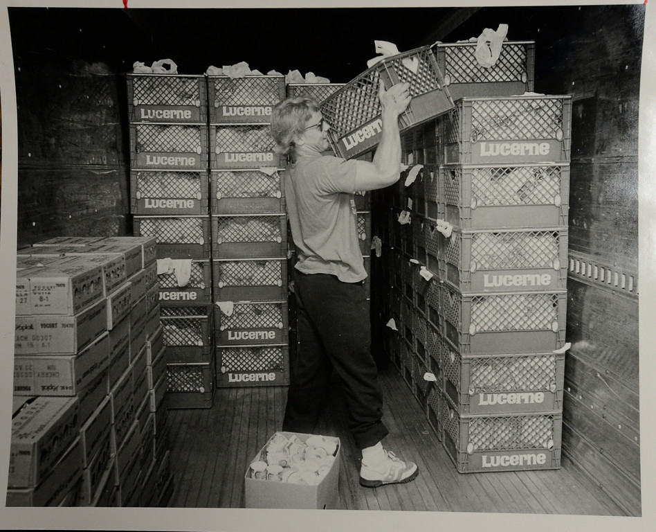 Jason Spritzer stacks lunches in a refrigerated truck for the 1986 Bolder Boulder.