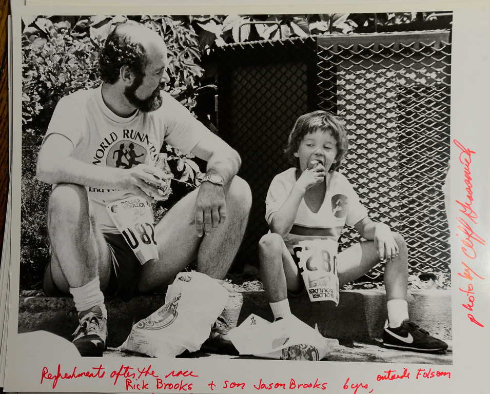 Rick Brooks eats with his son Jason outside Folsom Field after the 1985 Bolder Boulder. <br /> Photo by Cliff Grassmick