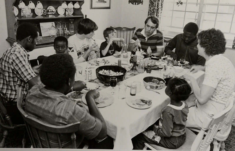 Runner Gabriel Kamau eats with the Ryan family in 1983.