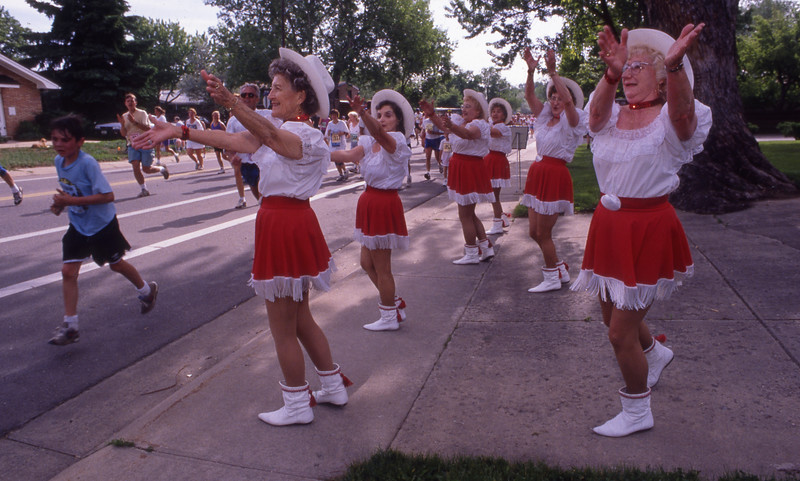 Cowgirls cheer for the runners in the 1993 Bolder Boulder.