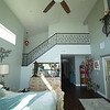 NEW MASTER BEDROOM WITH STAIRS LEADING TO PRIVATE STUDIO