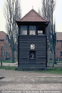 Guard tower in Auschwitz I. The barracks in the background are two story brick structures built with prisoner labor.