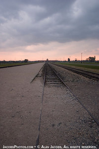 View of the ramp at Birkenau from the back. On each side of these tracks were crematoria and gas chambers, (KII, KIII) For views of them go to  interactive map of Birkenau       http://www.remember.org/camps/birkenau/index.html