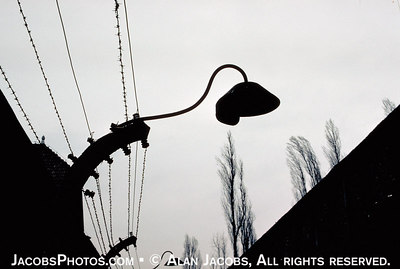 Auschwitz I lamp on the electrified barbed wire fence; a lamp with no light.
