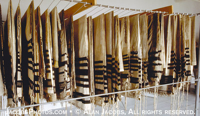 Jewish prayer shawls (Tallis') stolen from those deported to Auschwiz hanging mutely in an Auschwitz Museum storage room. photo 1979.