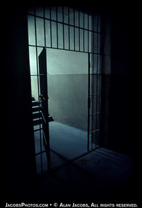 """Bars down to the punishment cells in the basement of Block 11. Most modern prisons have an isolation unit, colloquially known as """"the hole"""". Block ii was a place of torture, murder by shooting, suffocation and starvation. For a virtual look at some of the cells in this basement see http://www.remember.org/auschwitz/ and then go to #12."""