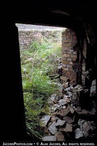 A basement door in the SS dynamited Krematorium III, Birkenau, (photo 1980). For interactive map of Birkenau go to        http://www.remember.org/camps/birkenau/index.html