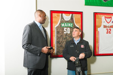 Maine Red Claws president Dajuan Eubanks (left) speaks to a member of the media during a Press Conference at the Maine Red Claws Corporate Offices in Portland, Maine on September 19 2014. The Maine Red Claws recently named Scott Morrison as the new Head Coach. (Photo by Michael McSweeney/Maine Red Claws).