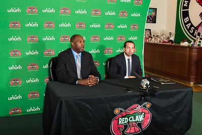 Maine Red Claws president Dajuan Eubanks (left) introduces the new Maine Red Claws head coach Scott Morrison (right) during a Press Conference at the Maine Red Claws Corporate Offices in Portland, Maine on September 19 2014. Coach Morrison is the 4th Head Coach in Maine Red Claws history. (Photo by Michael McSweeney/Maine Red Claws).
