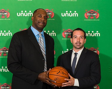 Maine Red Claws president Dajuan Eubanks (left) and Maine Red Claws head coach Scott Morrison (right) pose for a photo during a Press Conference at the Maine Red Claws Corporate Offices in Portland, Maine on September 19 2014. Coach Morrison was recently named the 4th Head Coach in Red Claws history. (Photo by Michael McSweeney/Maine Red Claws).
